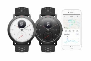 The white and black watch face options with the Health Mate app available for iOS and Android